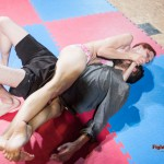 painful bodyscissors hold by the female wrestler