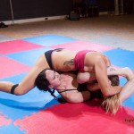 Competitive female wrestling action between Diana and Karina Gotika