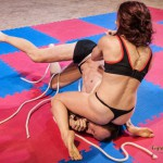 Veve controls her opponent by headsitting